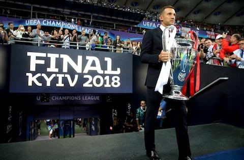Andriy Shevchenko brings the trophy out to the side of the pitch - Credit: Alexander Hassenstein - UEFA