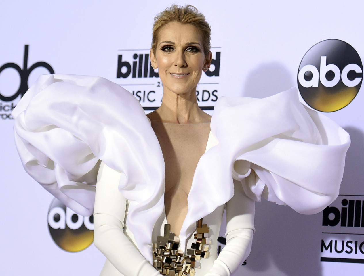 FILE - In this May 21, 2017 file photo, Celine Dion poses in the press room at the Billboard Music Awards in Las Vegas. Dion has announced she will end her Las Vegas residency next year. The singer announced on social media Monday, Sept. 24, 2018, that she will leave Caesars Palace in June 2019. (Photo by Richard Shotwell/Invision/AP, File)