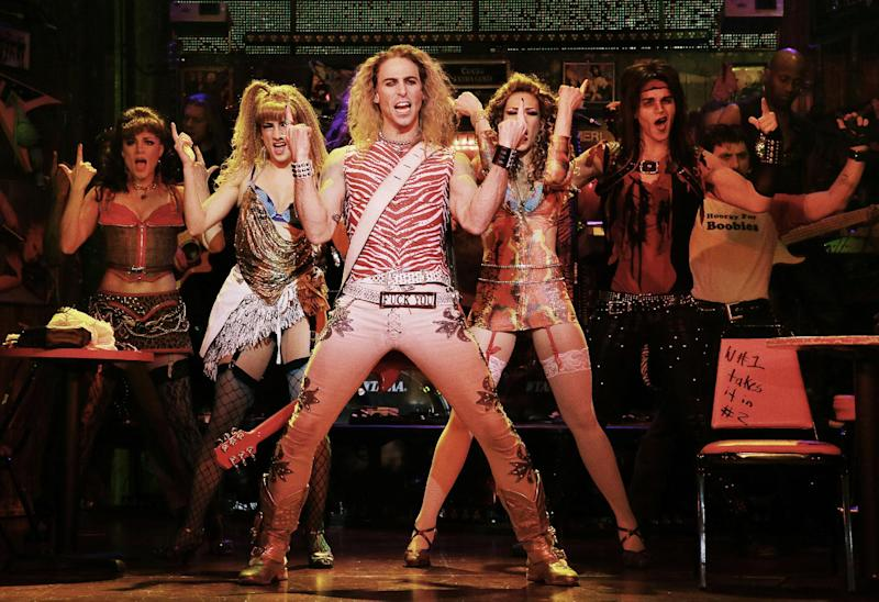 "This undated publicity photo released by the Vivacity Media Group shows Joey Calveri, center, as ""Stacee Jaxx"" in a scene from ""Rock of Ages,"" in New York. The cast of the Broadway show will be part of the televised pregame entertainment before Sunday's Super Bowl on Feb. 2, 2014. (AP Photo/Vivacity Media Group, Paul Kolnik)"
