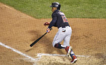 Cleveland Indians' Francisco Lindor (12) hits a one-run single against the Chicago Cubs during the fifth inning of a baseball game, Tuesday, Sept.15, 2020, in Chicago. (AP Photo/David Banks)