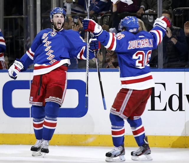 New York Rangers center Derick Brassard celebrates with right wing Mats Zuccarello (36) after scoring against the Montreal Canadiens during the second period of Game 4 of the NHL hockey Stanley Cup playoffs Eastern Conference finals, Sunday, May 25, 2014, in New York. (AP Photo/Kathy Willens)