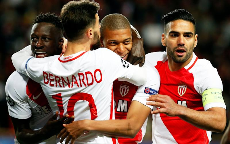 Mbappe (second from right) and Falcao (right) put the game beyond Dortmund within 17 minutes - EPA