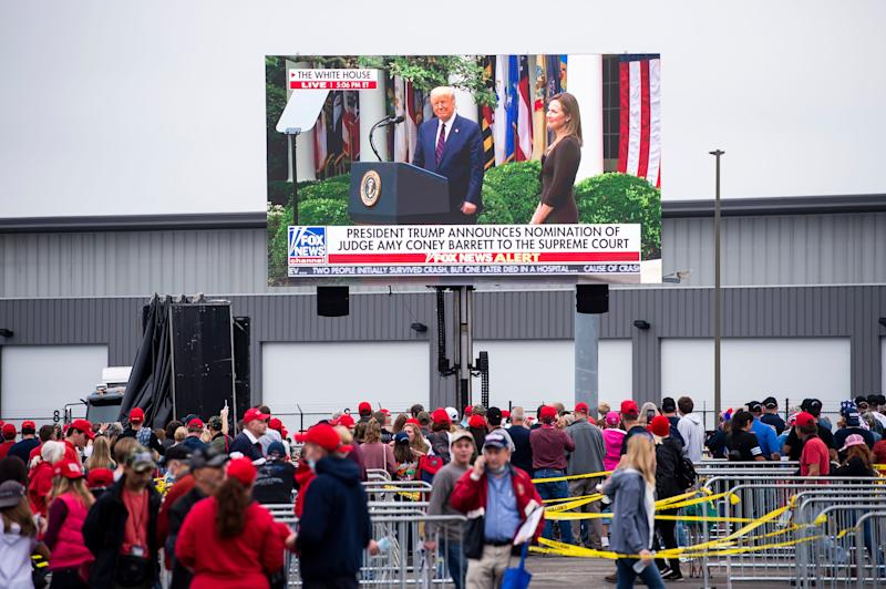 A live feed of Fox News is broadcast on a screen as supporters of President Donald Trump line up to go into a campaign rally Saturday, September 26, 2020, at Harrisburg International Airport in Middletown, Pa.