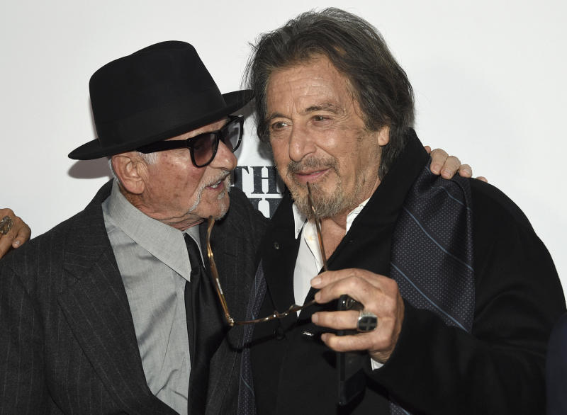 "Joe Pesci, left, and Al Pacino speak as they attend the world premiere of ""The Irishman"" at Alice Tully Hall during the opening night of the 57th New York Film Festival on Friday, Sept. 27, 2019, in New York. (Photo by Evan Agostini/Invision/AP)"