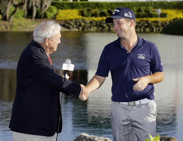 Matt Every, right, shakes hands with Arnold Palmer after winning the Arnold Palmer Invitational golf tournament at Bay Hill, Sunday, March 23, 2014, in Orlando, Fla. (AP Photo/Chris O'Meara)