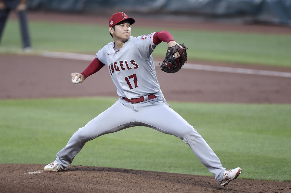 BALTIMORE, MARYLAND - AUGUST 25: Shohei Ohtani #17 of the Los Angeles Angels pitches in the first inning against the Baltimore Orioles at Oriole Park at Camden Yards on August 25, 2021 in Baltimore, Maryland. (Photo by Greg Fiume/Getty Images)