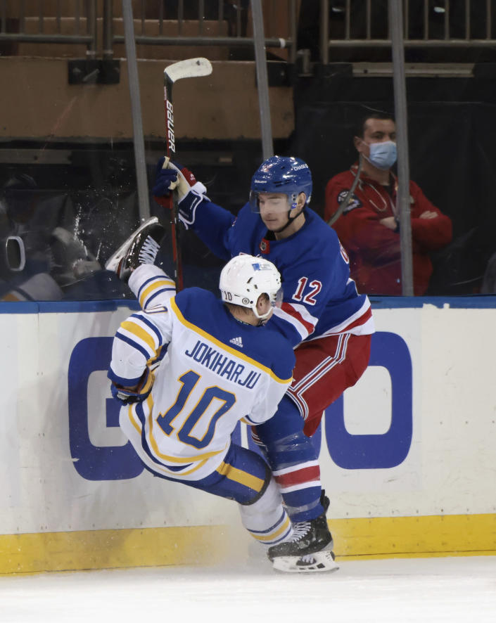 New York Rangers' Julien Gauthier (12) checks Buffalo Sabres' Henri Jokiharju (10 during the second period of an NHL hockey game Tuesday, March 2, 2021, in New York. (Bruce Bennett/Pool Photo via AP)