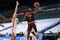 Iona's Asante Gist (2) goes up for a shot past Fairfield's Caleb Green (0) in the first half of an NCAA college basketball game during the finals of the Metro Atlantic Athletic Conference tournament, Saturday, March 13, 2021, in Atlantic City, N.J. (AP Photo/Matt Slocum)