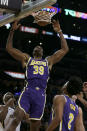 Los Angeles Lakers center Dwight Howard (39) watches his dunk against the Utah Jazz during the second half of an NBA basketball game in Los Angeles, Friday, Oct. 25, 2019. (AP Photo/Alex Gallardo)