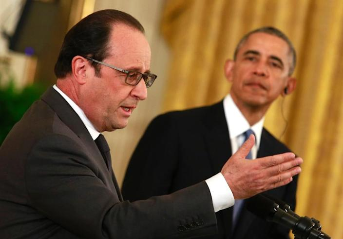 US President Barack Obama (R) and French President Francois Hollande hold a joint news conference after their meeting at the White House in Washington, DC on November 24, 2015 (AFP Photo/Yuri Gripas)