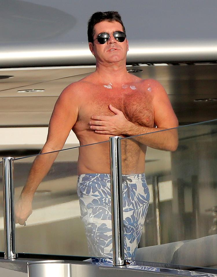 "50983164 ""X-Factor"" judge Simon Cowell spends the day aboard the Slipstream mega yacht in St. Barts catching some rays with friends on January 5th, 2013. *** NO FRANCE, NO GERMANY, NO ITALY, NO SPAIN*** FameFlynet, Inc - Beverly Hills, CA, USA -  1 (818) 307-4813 RESTRICTIONS APPLY: SEE CAPTION FOR RESTRICTIONS"