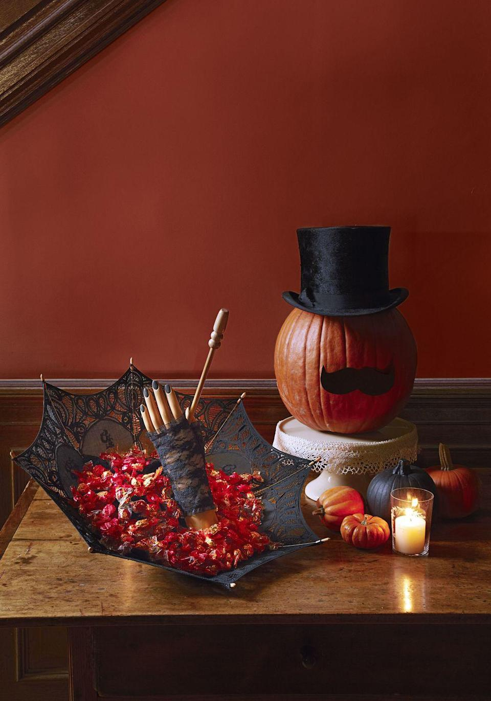 """<p>A top hat and paper mustache make for one fancy jack-o'-lantern — no scooping, carving or painting required. Prop the squash on a <a href=""""https://www.amazon.com/TRSPCWR-Dessert-Display-Cupcake-Birthday/dp/B08P84KTRS/?tag=syn-yahoo-20&ascsubtag=%5Bartid%7C10055.g.1714%5Bsrc%7Cyahoo-us"""" rel=""""nofollow noopener"""" target=""""_blank"""" data-ylk=""""slk:cake stand"""" class=""""link rapid-noclick-resp"""">cake stand</a> for an extra-dignified perch.</p><p><a class=""""link rapid-noclick-resp"""" href=""""https://www.amazon.com/Black-Magician-Costume-Funny-Party/dp/B007ZFXDLG?tag=syn-yahoo-20&ascsubtag=%5Bartid%7C10055.g.1714%5Bsrc%7Cyahoo-us"""" rel=""""nofollow noopener"""" target=""""_blank"""" data-ylk=""""slk:SHOP TOP HATS"""">SHOP TOP HATS</a><br></p>"""