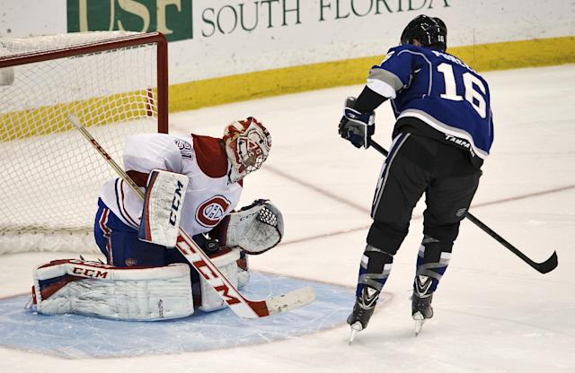 Montreal Canadiens goalie Carey Price (31) stops the game's final shot by Tampa Bay Lightning's Teddy Purcell (16) during an NHL hockey game Saturday, Dec. 28, 2013, in Tampa, Fla. The Canadiens defeated the Lightning 2-1 in a shootout. (AP Photo/Steve Nesius)