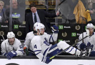 Toronto Maple Leafs center Auston Matthews (34) sits on the boards as head coach Mike Babcock gestures to his players on ice during the final seconds of the third period against the Boston Bruins in Game 7 of an NHL hockey first-round playoff series, Tuesday, April 23, 2019, in Boston. The Bruins won 5-1, eliminating the Leafs. (AP Photo/Charles Krupa)