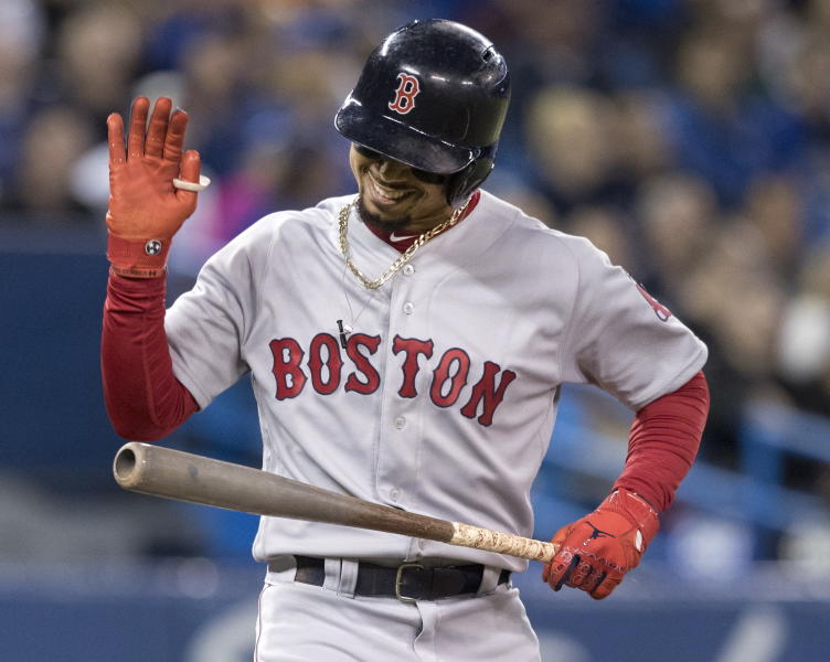 Boston Red Sox's Mookie Betts reacts after popping out in the third inning against the Toronto Blue Jays in a baseball game Thursday, Sept. 12, 2019, in Toronto. (Fred Thornhill/The Canadian Press via AP)