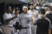 Chicago White Sox's Yoan Moncada (10) celebrates his two-run home run during the third inning of the team's baseball game against the Detroit Tigers in Detroit, Friday, Sept. 20, 2019. (AP Photo/Paul Sancya)
