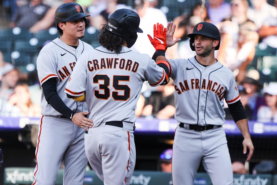 San Francisco Giants shortstop Brandon Crawford (35) celebrates after hitting a three-run home run against the Colorado Rockies in the ninth inning at Coors Field on Sunday.
