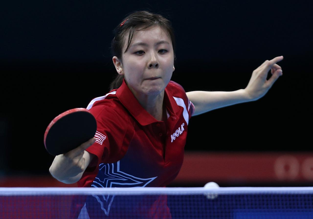 LONDON, ENGLAND - JULY 29:  Ariel Hsing of the United States plays a forehand in her Women's Singles second round match against Lian Xia Ni of Luxembourg on Day 2 of the London 2012 Olympic Games at ExCeL on July 29, 2012 in London, England.  (Photo by Feng Li/Getty Images)