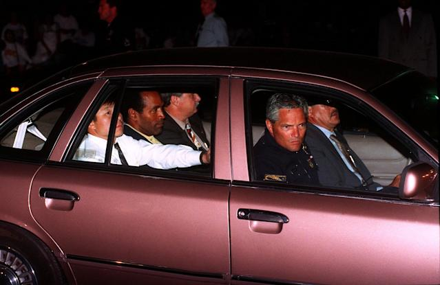 <p>O.J. Simpson, center of rear seat, is driven into the Los Angeles Police Department headquarters on Friday, June 17, 1994, after his arrest following a low-speed freeway chase which ended in the drive of his home in West Los Angeles. Simpson was charged with two counts of murder in connection with the slaying of his ex-wife Nicole, and Ron Goldman. (Photo: Bob Galbraith/AP) </p>