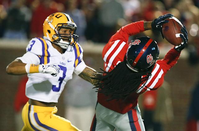 Mississippi defensive back Charles Sawyer (3) intercepts a pass intended for LSU wide receiver Odell Beckham Jr. (3) in the first half of an NCAA college football game in Oxford, Miss., Saturday, Oct. 19, 2013. (AP Photo/Rogelio V. Solis)