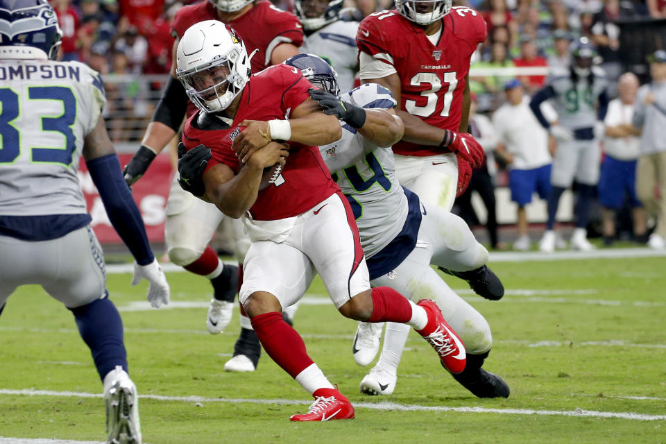 Arizona Cardinals quarterback Kyler Murray (1) scores a touchdown as Seattle Seahawks middle linebacker Bobby Wagner defends during the second half of an NFL football game, Sunday, Sept. 29, 2019, in Glendale, Ariz. (AP Photo/Ross D. Franklin)