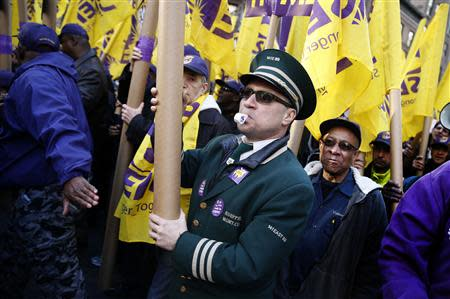 Doorman Joe Soto marches in his uniform with thousands of members of the Service Employees International Union (SEIU) during a protest in support of a new contract for apartment building workers in New York City, April 2, 2014. REUTERS/Mike Segar