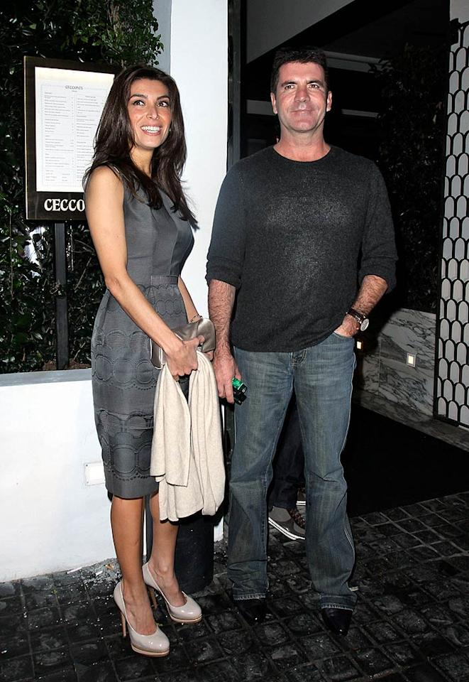 "Also rumored to be shackin' up? Simon Cowell and his make-up artist girlfriend, Mezhgan Hussainy. The ecstatic bride-to-be told RadarOnline that she and the ""American Idol"" judge were ""officially engaged."" Here's hoping that being in love doesn't soften Cowell's acerbic wit too much! epa/<a href=""http://www.x17online.com"" target=""new"">X17 Online</a> - February 20, 2010"