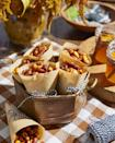 """<p>Wrapped in cones of parchment paper and tied with twine, this crunchable snack is great for when guests are mingling.</p><p><strong><a href=""""https://www.countryliving.com/food-drinks/a34945277/spicy-n-sweet-snack-mix-recipe/"""" rel=""""nofollow noopener"""" target=""""_blank"""" data-ylk=""""slk:Get the recipe"""" class=""""link rapid-noclick-resp"""">Get the recipe</a>.</strong></p>"""