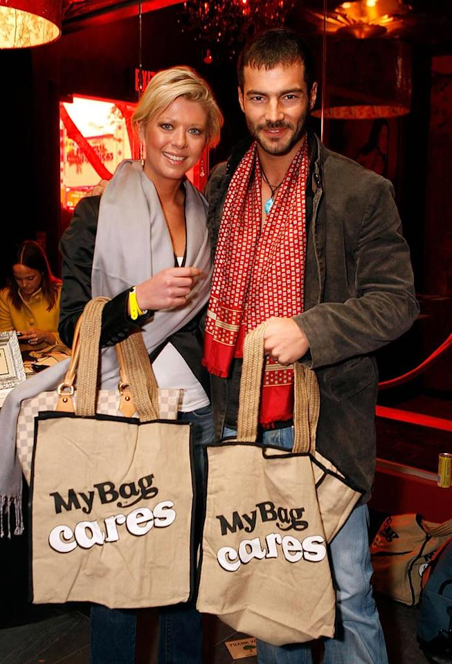 """Tara and a friend promoted eco-friendly shopping by posing at the My Bag Cares display. Marsaili McGrath/<a href=""""http://www.wireimage.com"""" target=""""new"""">WireImage.com</a> - February 21, 2008"""