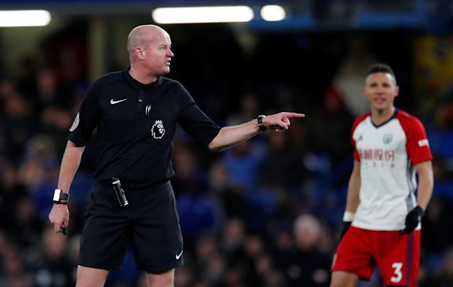 "Soccer Football - Premier League - Chelsea vs West Bromwich Albion - Stamford Bridge, London, Britain - February 12, 2018 Referee Lee Mason Action Images via Reuters/Andrew Couldridge EDITORIAL USE ONLY. No use with unauthorized audio, video, data, fixture lists, club/league logos or ""live"" services. Online in-match use limited to 75 images, no video emulation. No use in betting, games or single club/league/player publications. Please contact your account representative for further details."