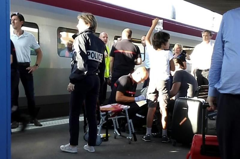 A passenger receives medical attention in Arras, northern France, after being injured in a gun attack on August 21, 2015 onboard a train between Amsterdam and Paris (AFP Photo/Rafael Benamran)