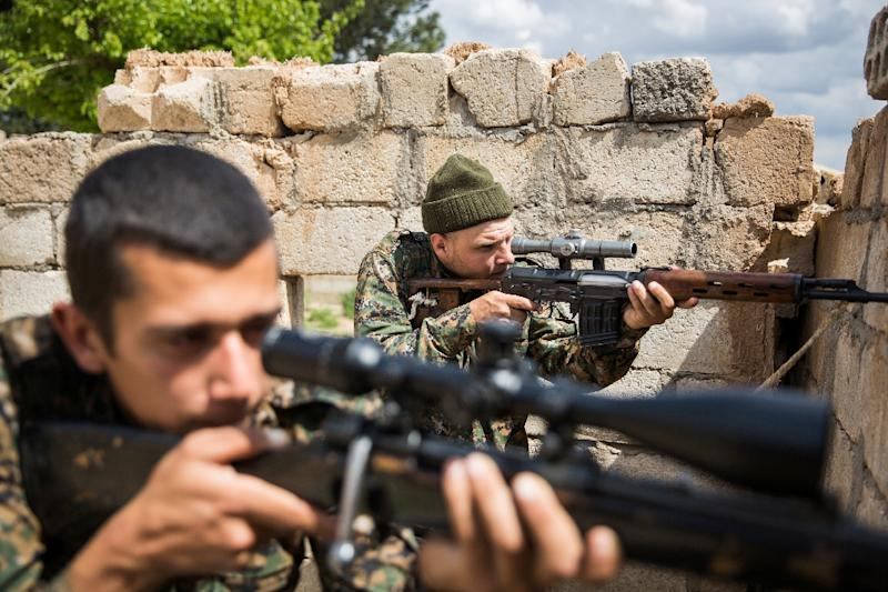 Control of Hasakeh is divided between government loyalists and Kurdish militia who are mostly present in the city's north and northwest (AFP Photo/Uygar Onder Simsek)