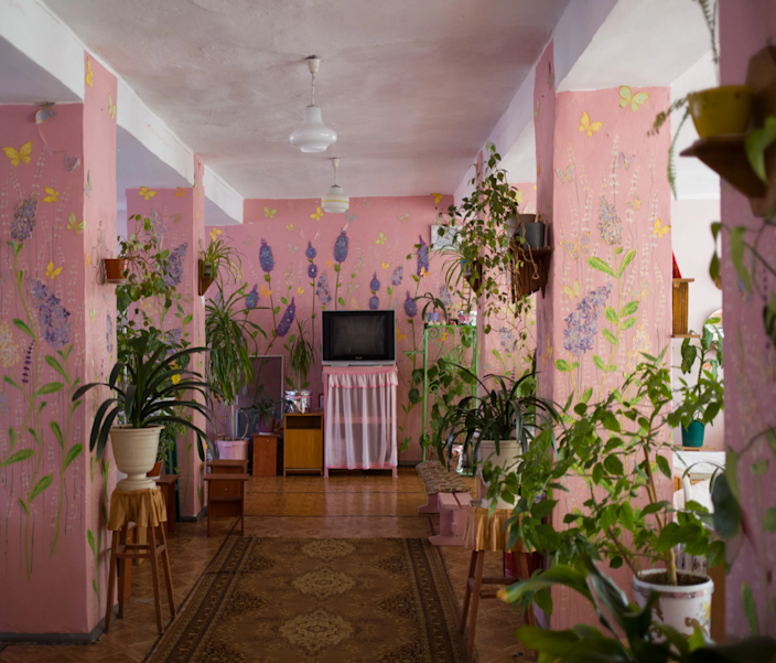 A bright pink television room inside a Ukrainian women's prison.