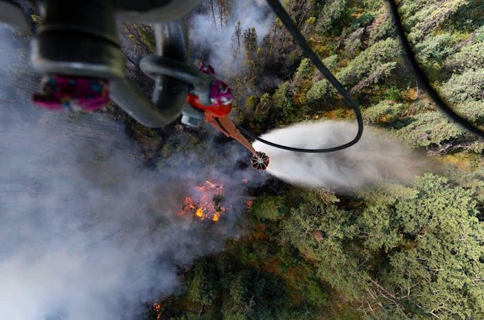 "<span class=""caption"">A helicopter drops water on a forest fire in Alaska.</span> <span class=""attribution""><a class=""link rapid-noclick-resp"" href=""https://www.flickr.com/photos/thenationalguard/48233324007/"" rel=""nofollow noopener"" target=""_blank"" data-ylk=""slk:Michael Risinger/U.S. Army National Guard"">Michael Risinger/U.S. Army National Guard</a>, <a class=""link rapid-noclick-resp"" href=""http://creativecommons.org/licenses/by/4.0/"" rel=""nofollow noopener"" target=""_blank"" data-ylk=""slk:CC BY"">CC BY</a></span>"