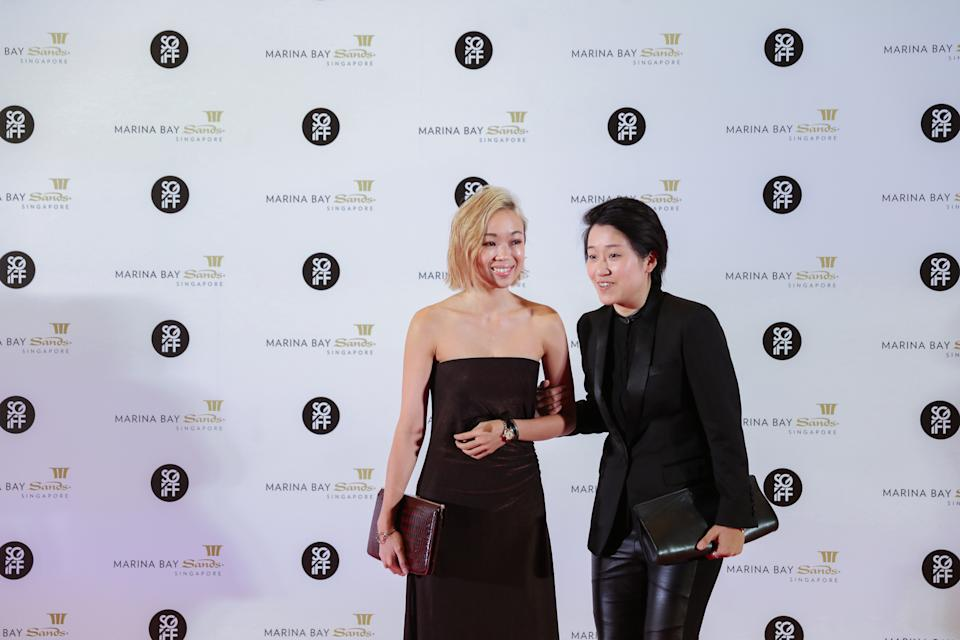 (Left -Right) Singaporean writer Amanda Lee Koe and film maker Kirsten Tan oblige for photos on the red carpet during their attendance at the 28th SGIFF Benefit Dinner at the Marina Bay Sands Expo & Convention Centre. (Photo: Don Wong for Yahoo Lifestyle Singapore)