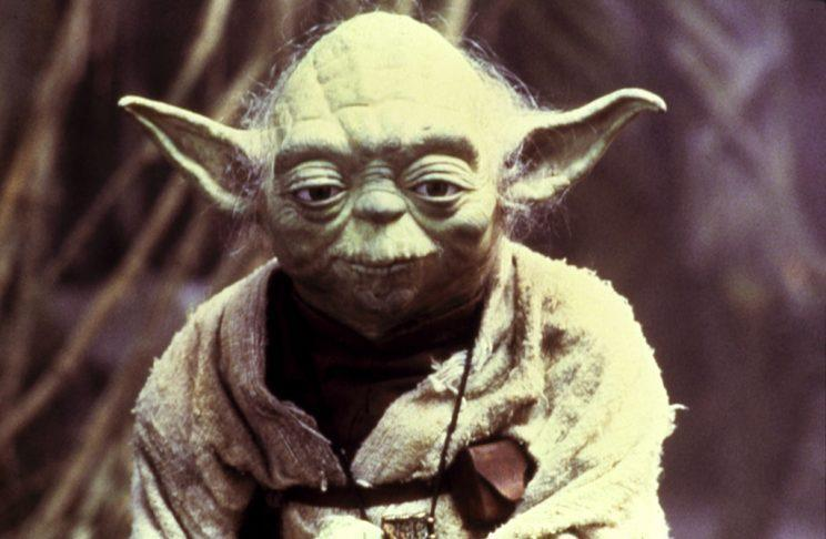 Yoda, seen here in <em>The Empire Strikes Back</em>, has parallels in many religious traditions. (Photo: Everett)
