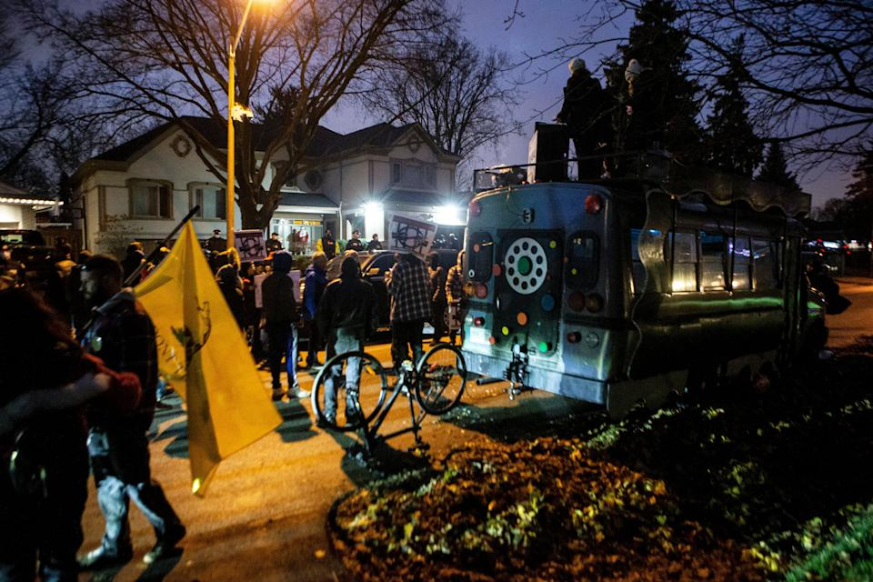 Protesters gather outside of Ontario Premier Doug Ford's home following the arrest of Adam Skelly in Etobicoke, Ont. on Nov. 26, 2020. Skelly owns a BBQ restaurant which opened in defiance of COVID-19 restrictions. (Photo: The Canadian Press)