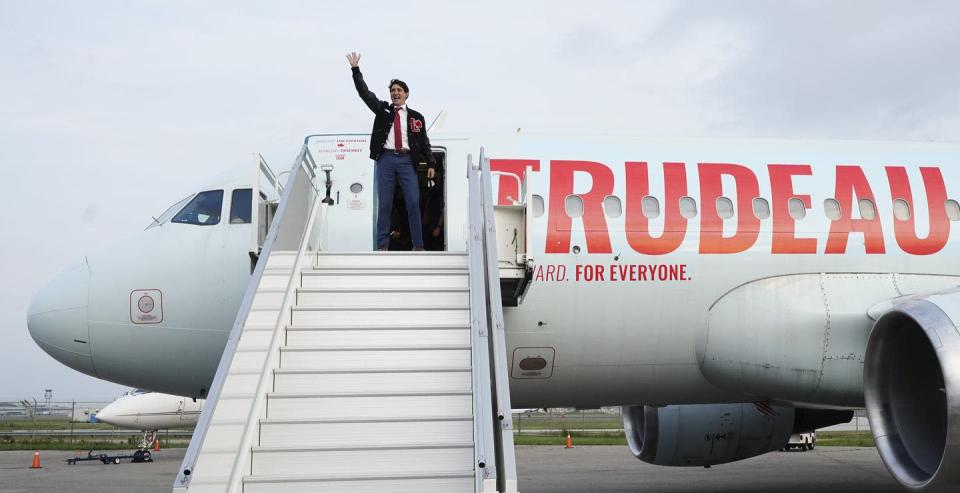 """<span class=""""caption"""">Justin Trudeau boards his campaign plane in Toronto on Aug. 17. </span> <span class=""""attribution""""><span class=""""source"""">THE CANADIAN PRESS/Sean Kilpatrick</span></span>"""