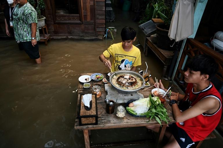 The watery dining experience has proved popular with young people and families (AFP/Lillian SUWANRUMPHA)