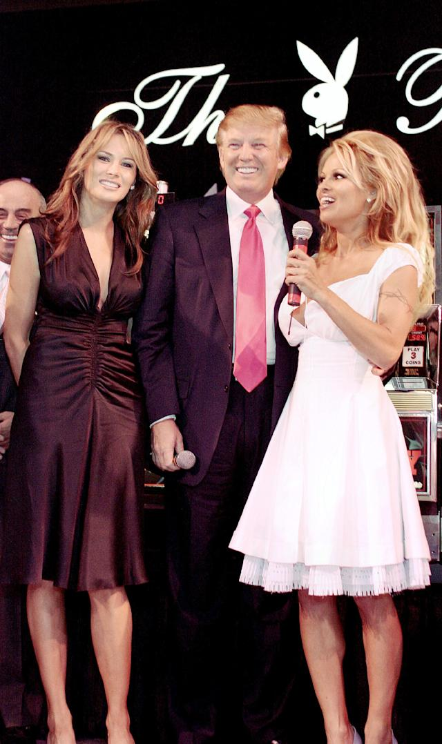 """<p>Pamela Anderson stands onstage with Melania and Donald Trump to announce the winners in his special """"Donald J. Trump Birthday Quarter Million Dollar Giiveaway"""" celebration on June 11, 2005, in Atlantic City. (Photo: Donald Kravitz/Getty Images) </p>"""