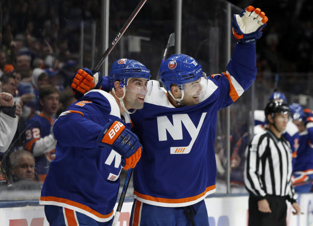 New York Islanders defenseman Nick Leddy (2) celebrates his goal against the Anaheim Ducks with teammate Derick Brassard (10) during the second period of an NHL hockey game, Saturday, Dec. 21, 2019, in Uniondale, N.Y. (AP Photo/Jim McIsaac)