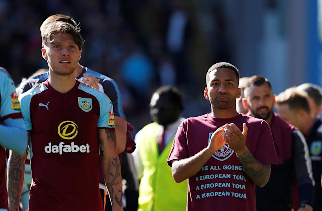 "Soccer Football - Premier League - Burnley vs AFC Bournemouth - Turf Moor, Burnley, Britain - May 13, 2018 Burnley's Aaron Lennon and Burnley's Jeff Hendrick applaud their fans during a lap of honour after the match REUTERS/Andrew Yates EDITORIAL USE ONLY. No use with unauthorized audio, video, data, fixture lists, club/league logos or ""live"" services. Online in-match use limited to 75 images, no video emulation. No use in betting, games or single club/league/player publications. Please contact your account representative for further details."