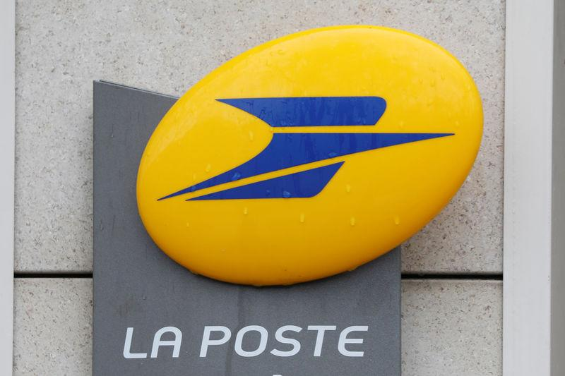 The logo of French postal service company La Poste is seen on a post office in Paris