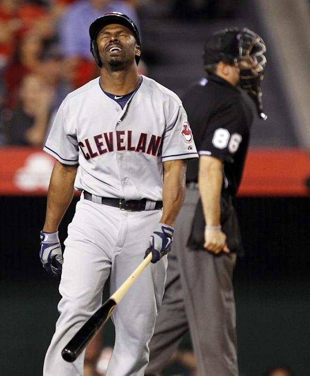 Cleveland Indians' Michael Bourn rues striking out with two runners on base to end the fifth inning of a baseball game against the Los Angeles Angels on Tuesday, April 29, 2014, in Anaheim, Calif. (AP Photo/Alex Gallardo)