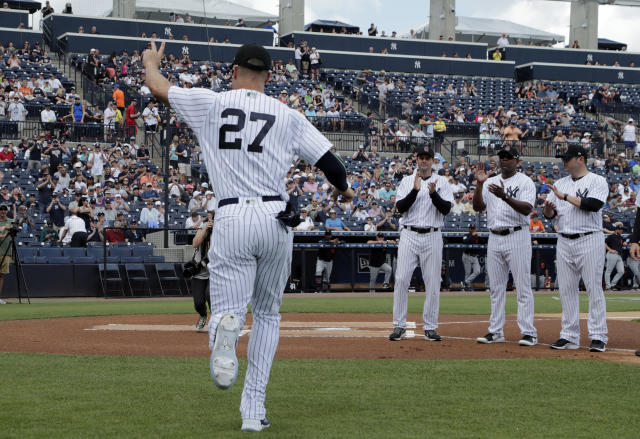 New York Yankees' Giancarlo Stanton (27) waves as he is introduced before a baseball spring exhibition game against the Detroit Tigers, Friday, Feb. 23, 2018, in Tampa, Fla. (AP Photo/Lynne Sladky)