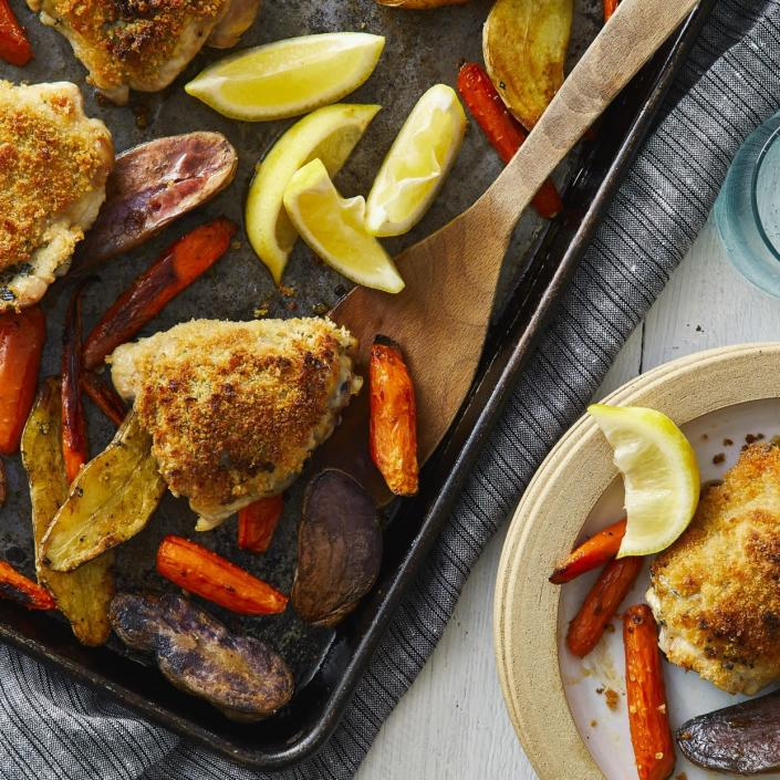 <p>Panko breadcrumbs make this healthy lemon-garlic chicken super-crispy on the outside, while a bit of mayonnaise amps up the juiciness of the thighs. And everything--including fingerling potatoes and carrots--cooks on one sheet pan, so this healthy dinner is super-easy to prep and clean up after too. You can swap out the potatoes and carrots for other vegetables, such as broccoli and parsnips, but just be sure to adjust the cooking time accordingly.</p>