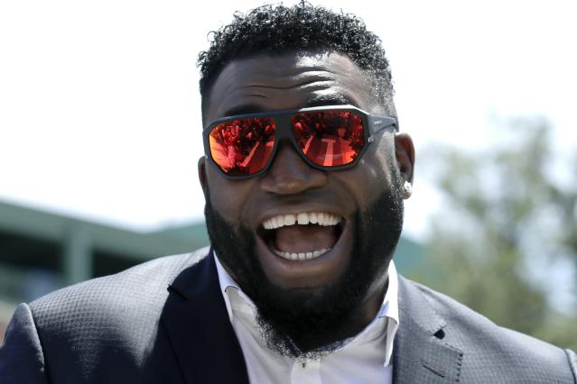 FILE - In this June 22, 2017, file photo, retired Boston Red Sox designated hitter David Ortiz, smiles outside Fenway Park in Boston. Ortiz is selling a lot of memorabilia from his baseball career at an estate sale scheduled for Saturday, Feb. 29, 2020, at his home in the affluent Boston suburb of Weston. (AP Photo/Charles Krupa, File)