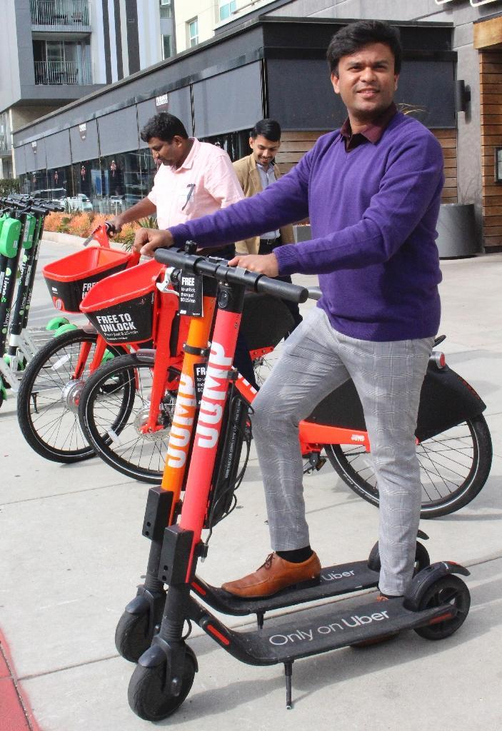 "The vision of ""sharing economy"" startups like Uber is to vastly reduce the number of private cars on the roads, with travelers turning to sharing of cars, bikes and electric scooters (AFP Photo/Glenn CHAPMAN)"