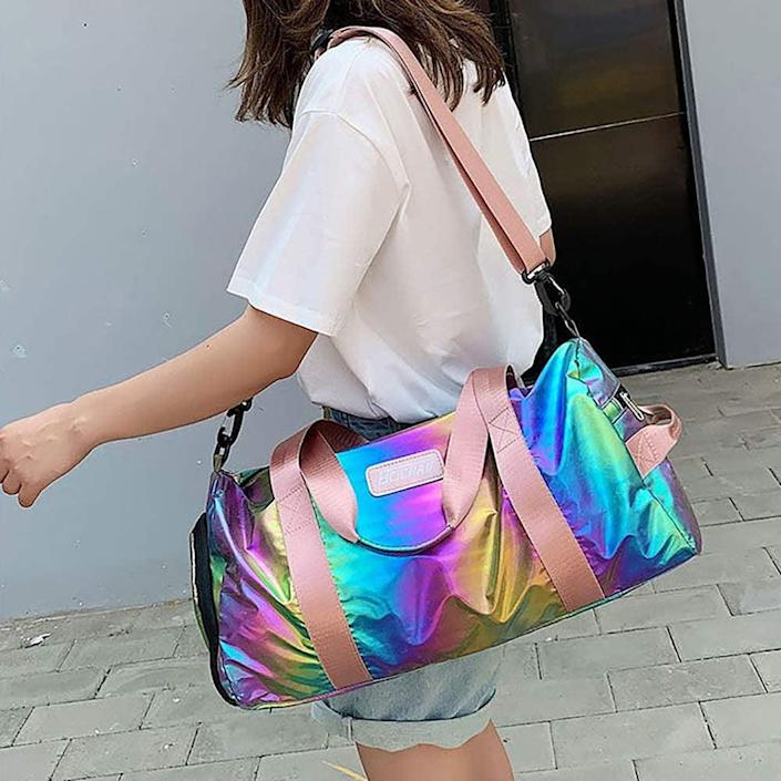 <p>The lightweight, waterproof <span>Spring Country Gym Duffel Bag </span> ($24) will make a statement. This holographic rainbow bag has multiple compartments and event one just for shoes. </p>