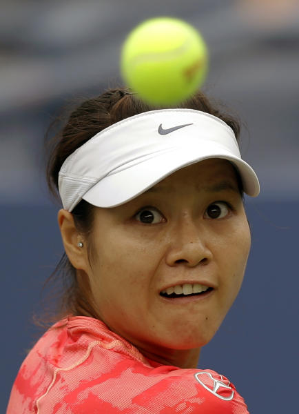 China's Li Na returns a shot to Belarus's Olga Govortsova during the first round of the 2013 US Open tennis tournament, Monday, Aug. 26, 2013, in New York. (AP Photo/Kathy Willens)